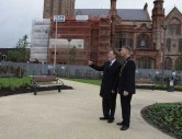 The Mayor of Derry City Centre shows Minister McCausland around the Guildhall Urban Park in Londonderry